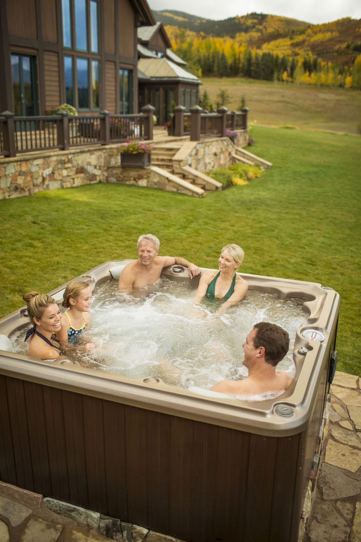 Family sitting in Jacuzzi Hot Tub